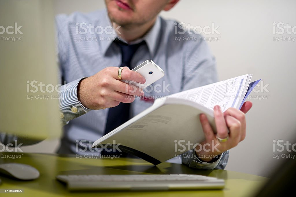Cutting edge qr code technology used in the workplace stock photo