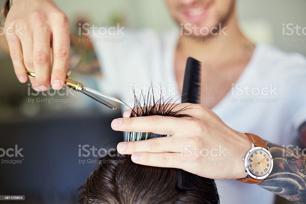 Cutting ends of hair stock photo