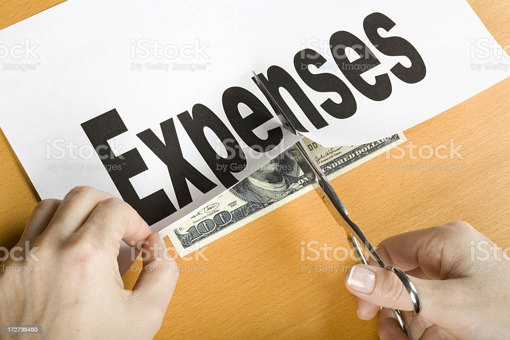 Cutting expenses concept royalty-free stock photo