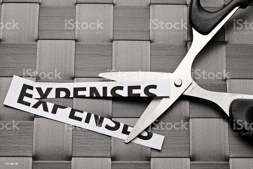cutting expenses stock photo