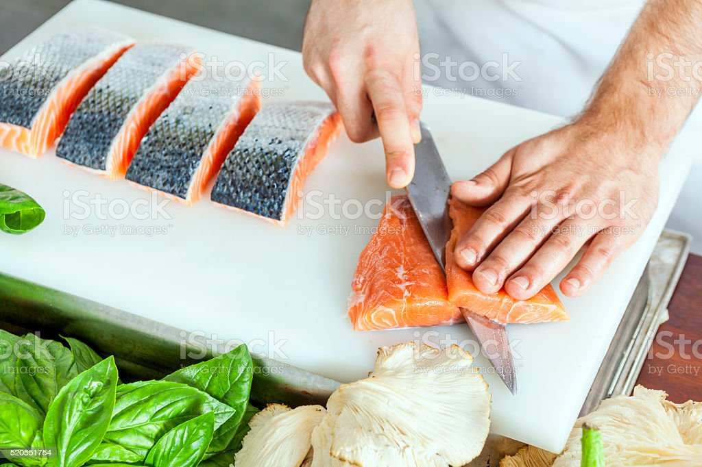 Cutting fish stock photo