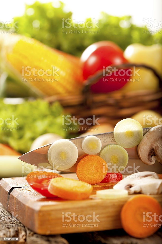 Cutting fresh organic vegetables royalty-free stock photo