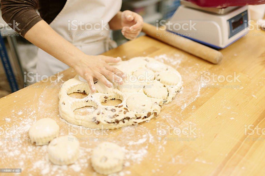 Cutting fruit scones stock photo