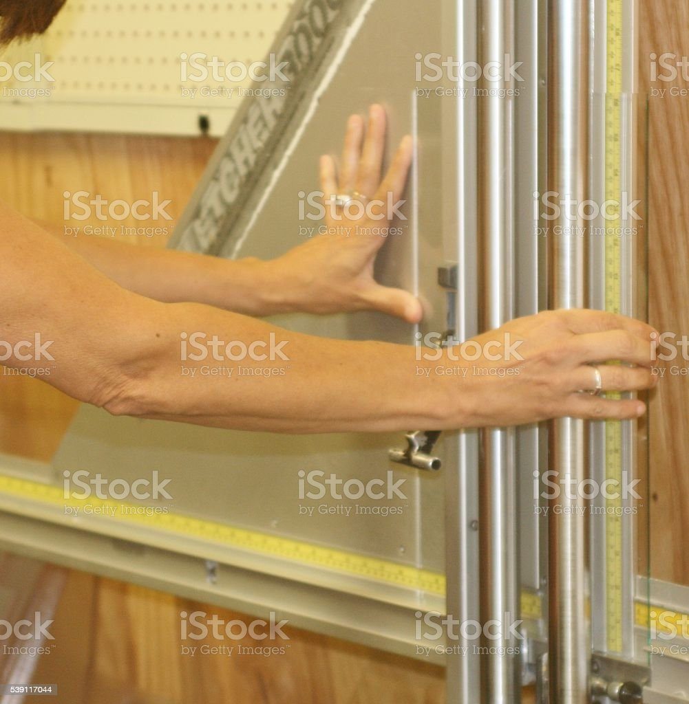 Cutting Glass stock photo