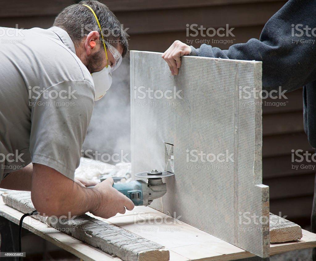 Cutting Granite stock photo
