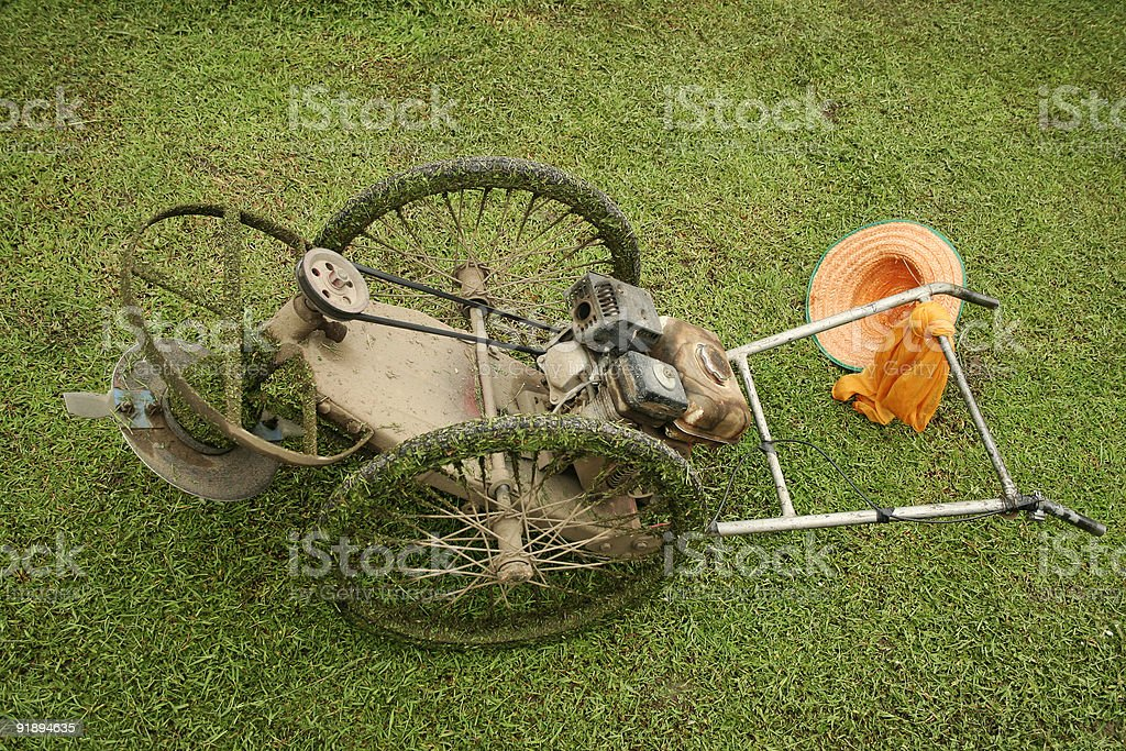 cutting grass old fashioned lawn mower royalty-free stock photo