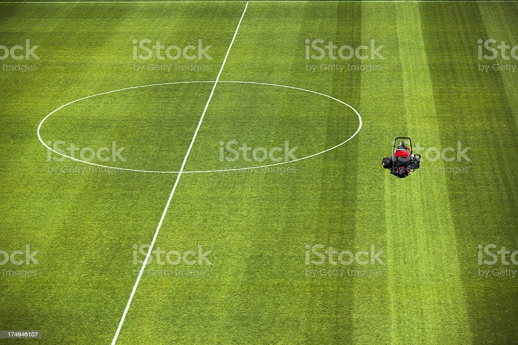 Cutting grass turf lines on a sports field stock photo