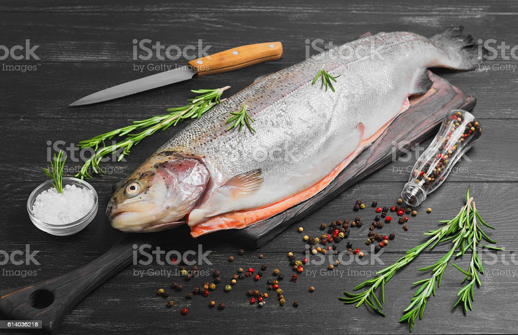 Cutting gutted red fish trout stock photo