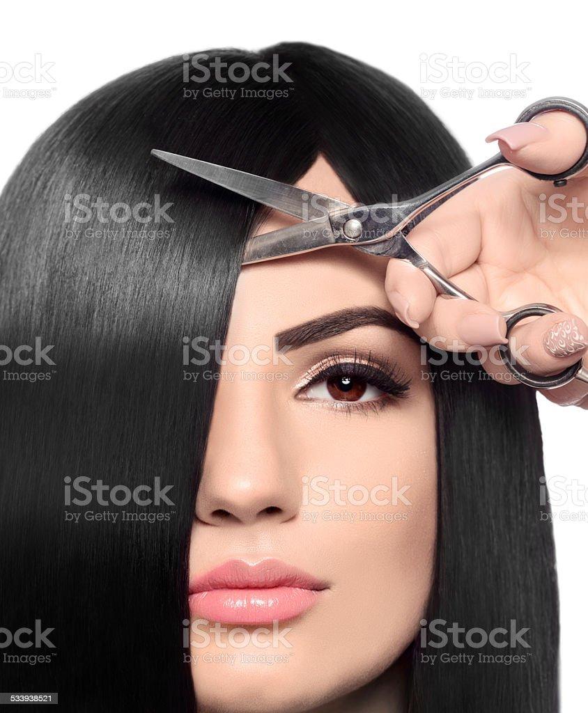 cutting hair at hairsalon stock photo