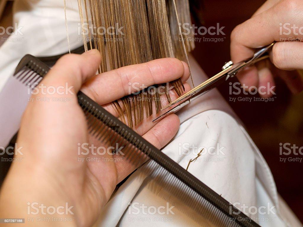 Cutting hair at the hair studio stock photo