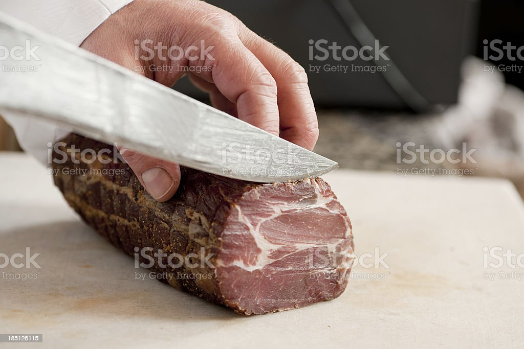 Cutting ham stock photo