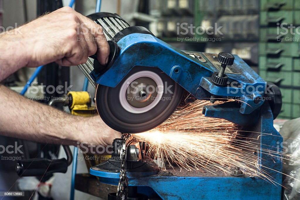 Cutting in the repair shop stock photo