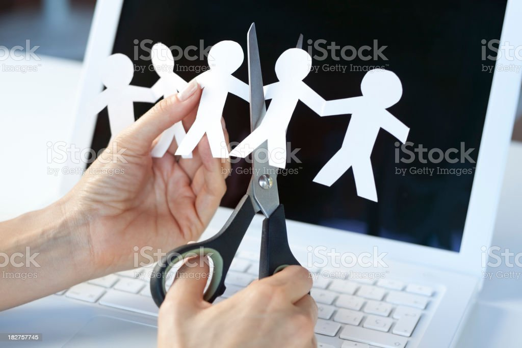 Cutting jobs or downsizing concept royalty-free stock photo