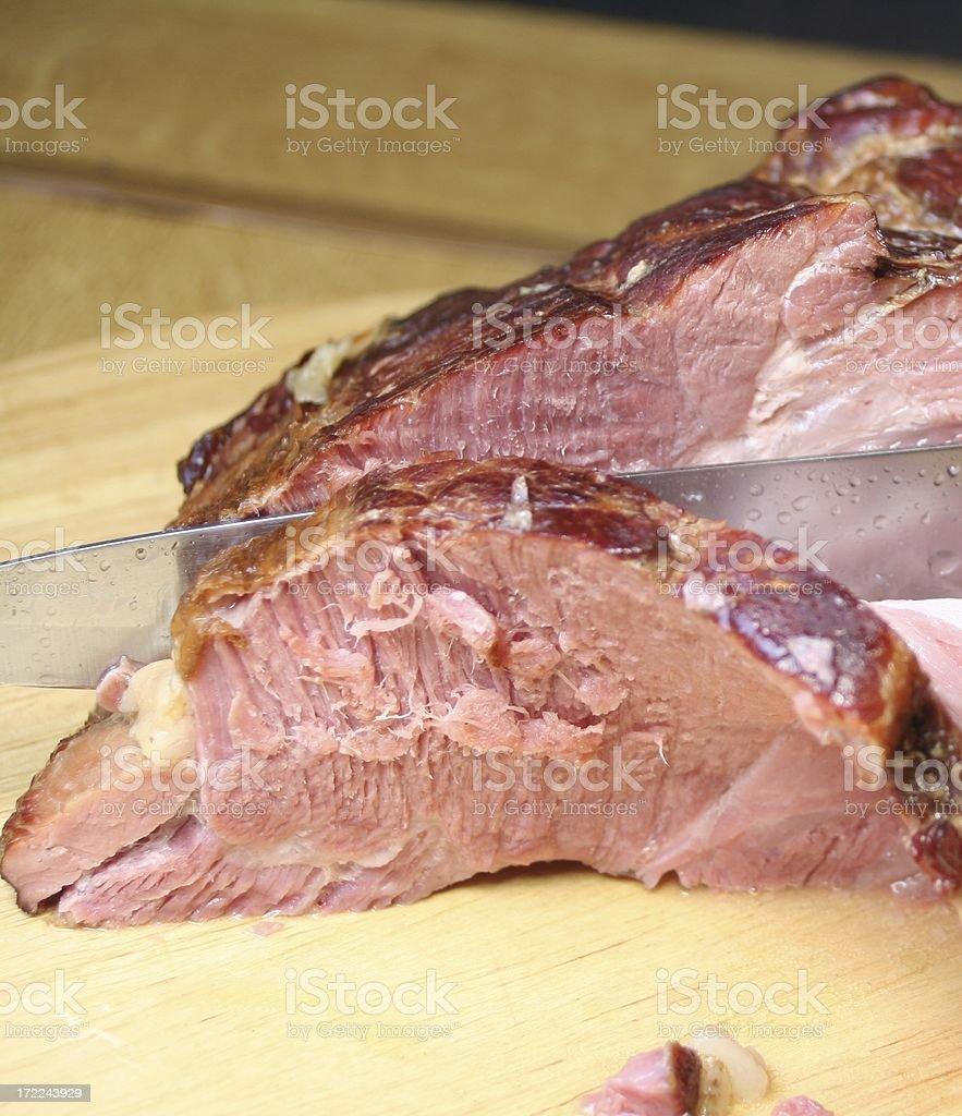 Cutting kasseler stock photo
