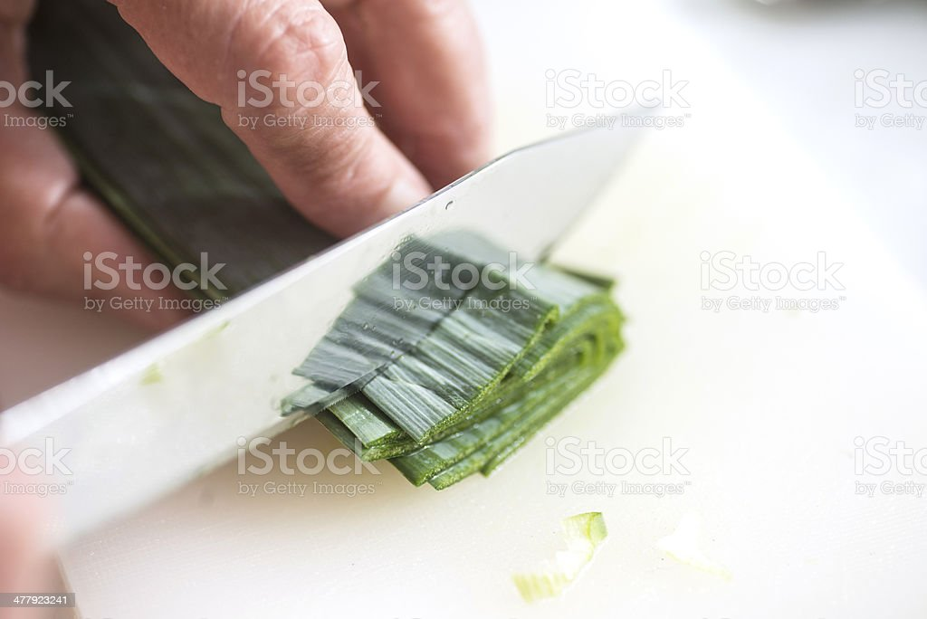 cutting leek royalty-free stock photo