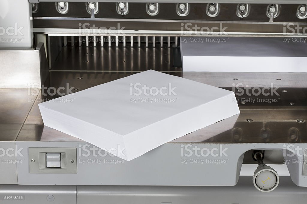 Cutting machine with paper stock photo