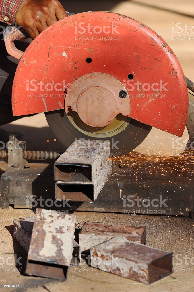 cutting metal and steel with compound mitre saw with sharp stock photo