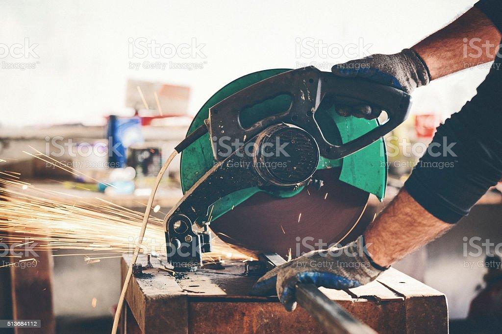 Cutting metal bar close up shot stock photo