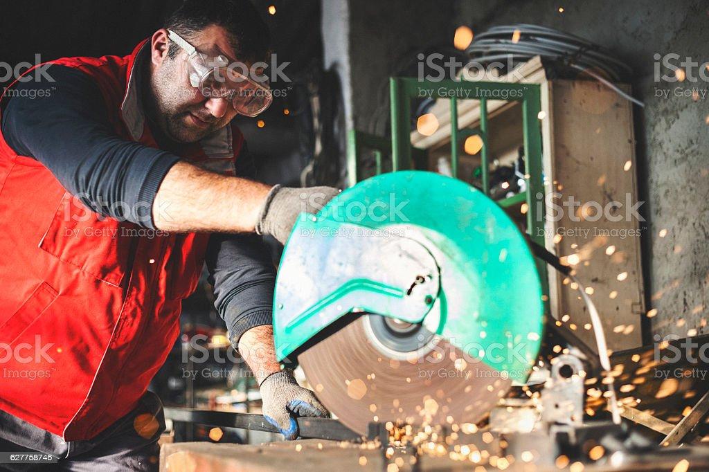 Cutting metal bars stock photo