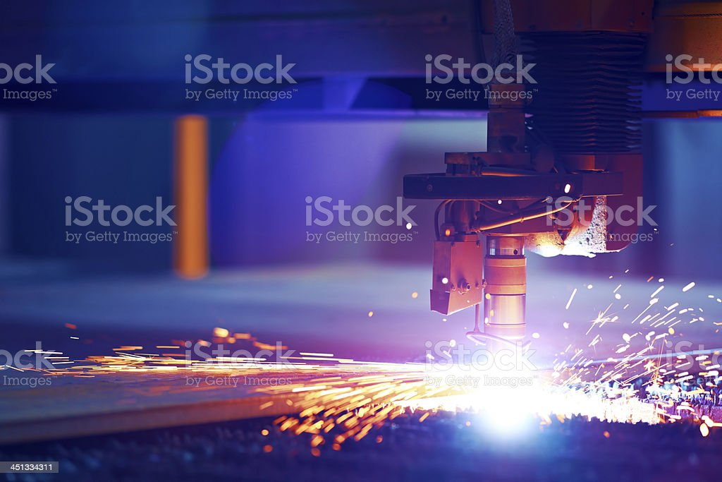 Cutting metal by plasma laser stock photo