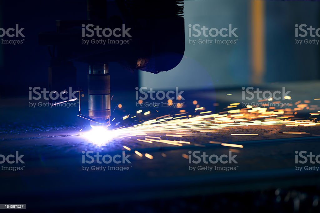 Cutting metal with a plasma laser stock photo