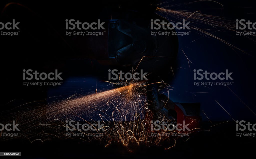 Cutting metal with angle grinder stock photo
