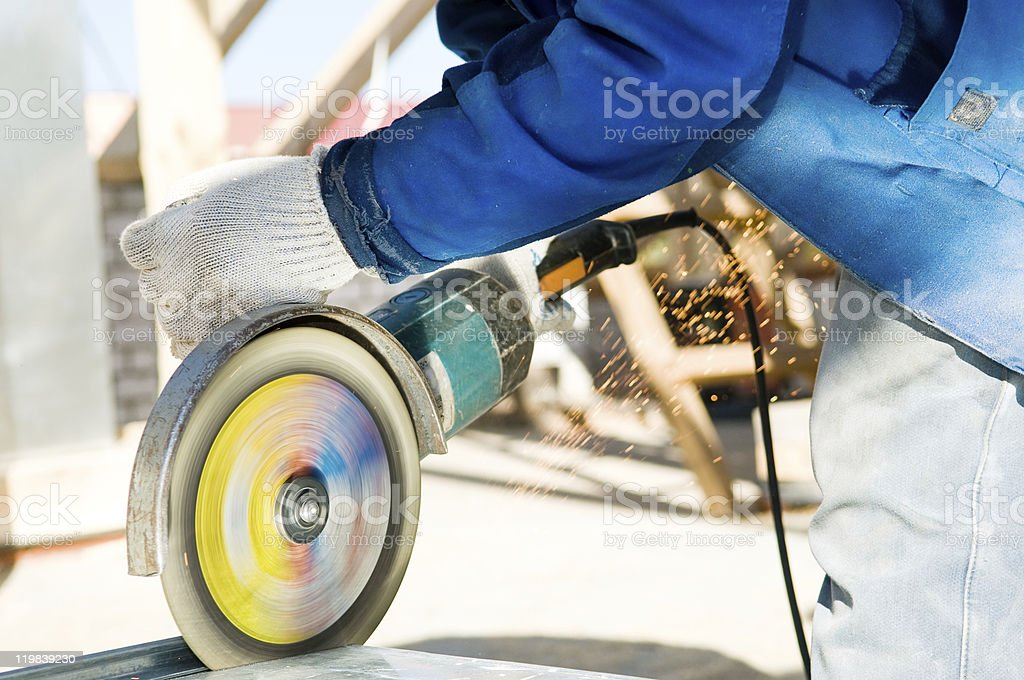 cutting metal with grinder saw stock photo