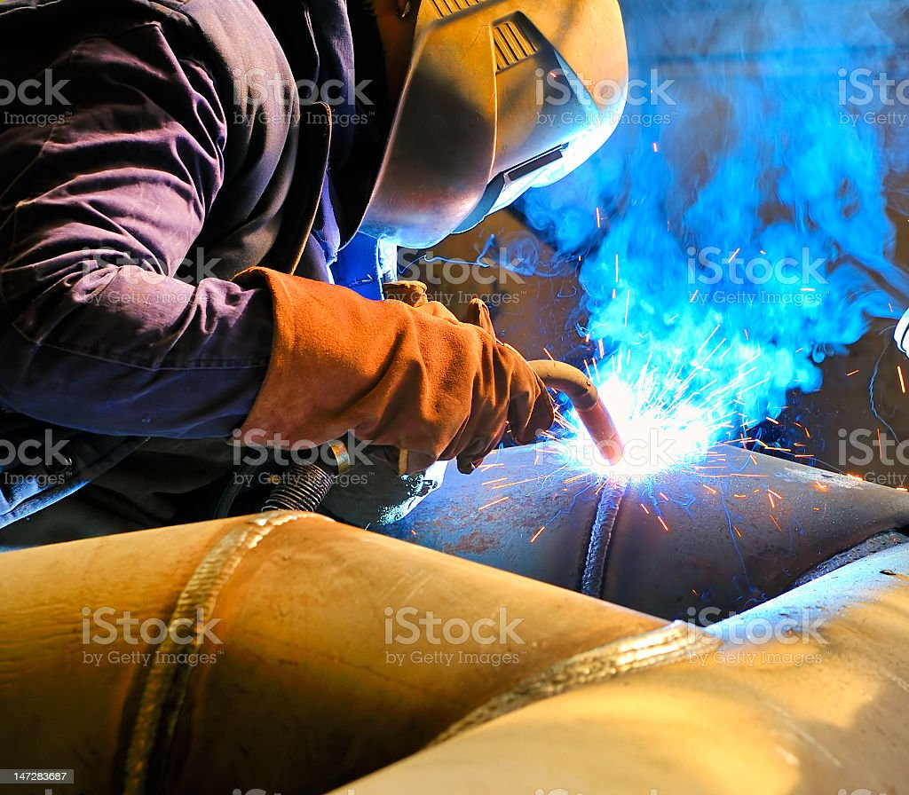 Cutting metal with mig welder royalty-free stock photo