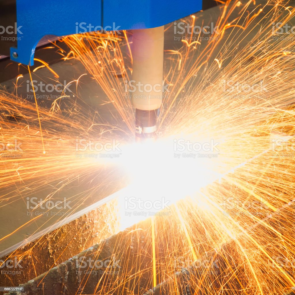 Cutting of metal. Sparks fly from laser stock photo