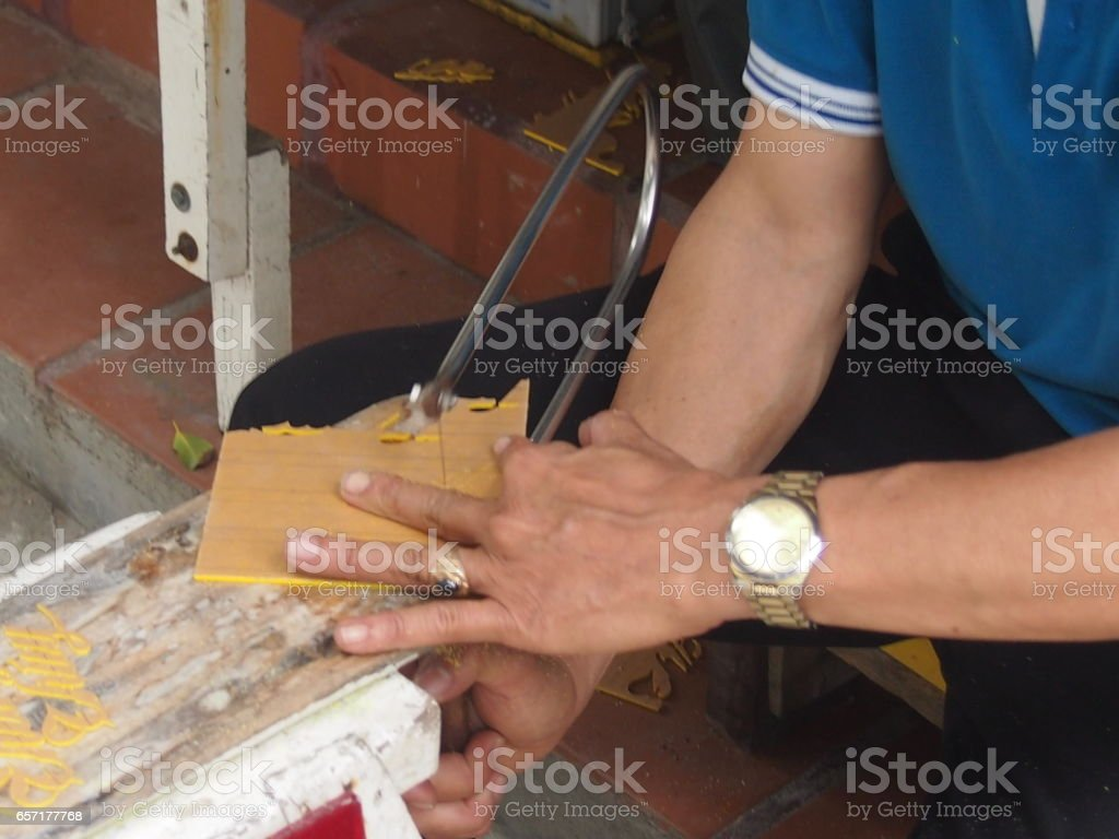 Cutting out by a fret saw stock photo