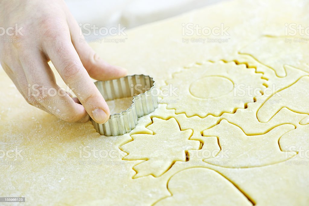 Cutting out cookies from dough stock photo