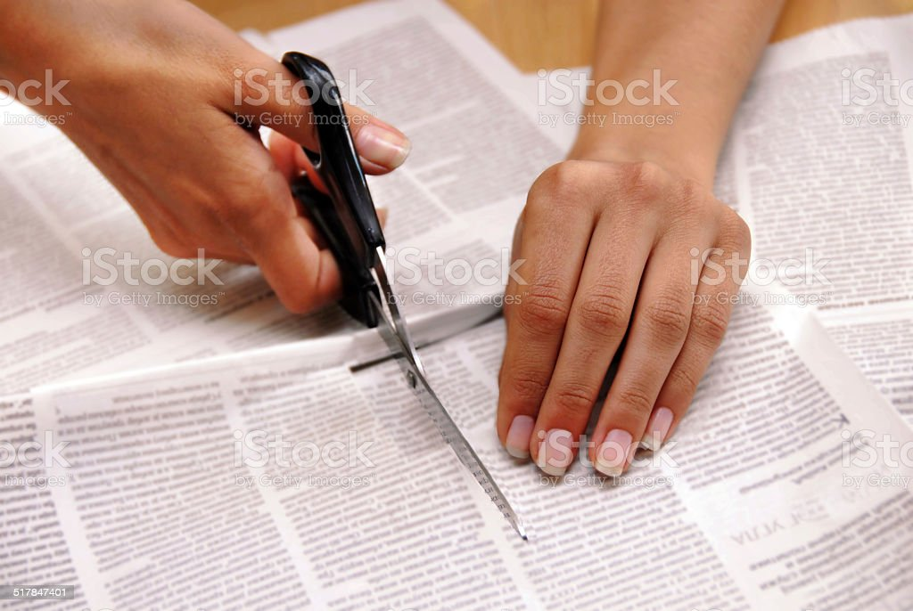 Cutting out from newspapers stock photo