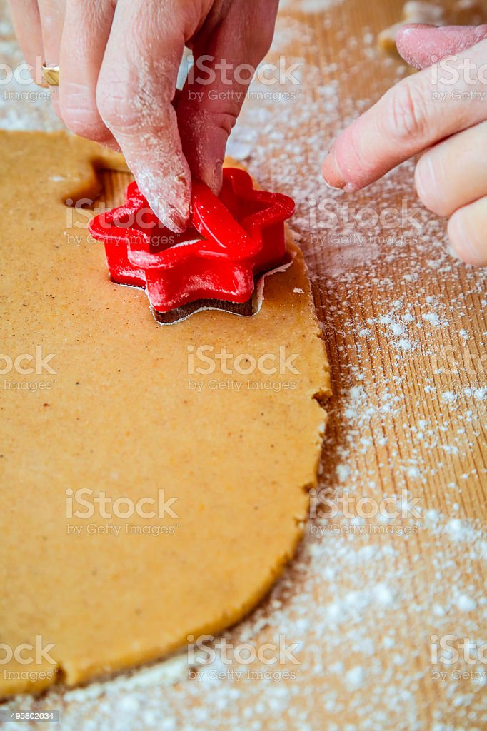 Cutting out star shape cookie stock photo