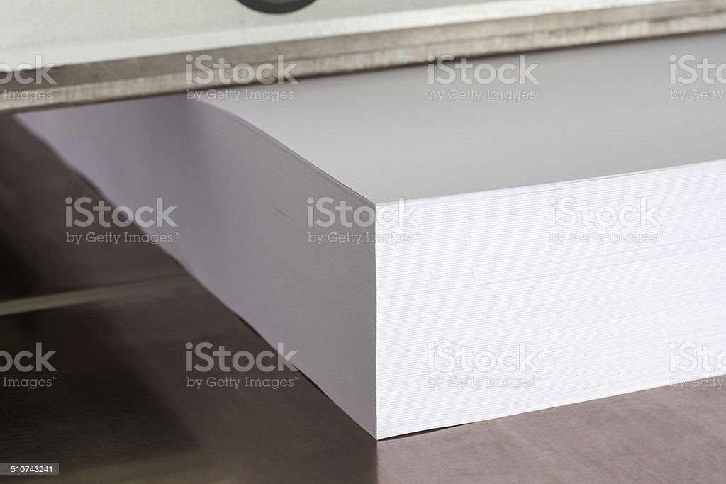 Cutting paper with machine stock photo