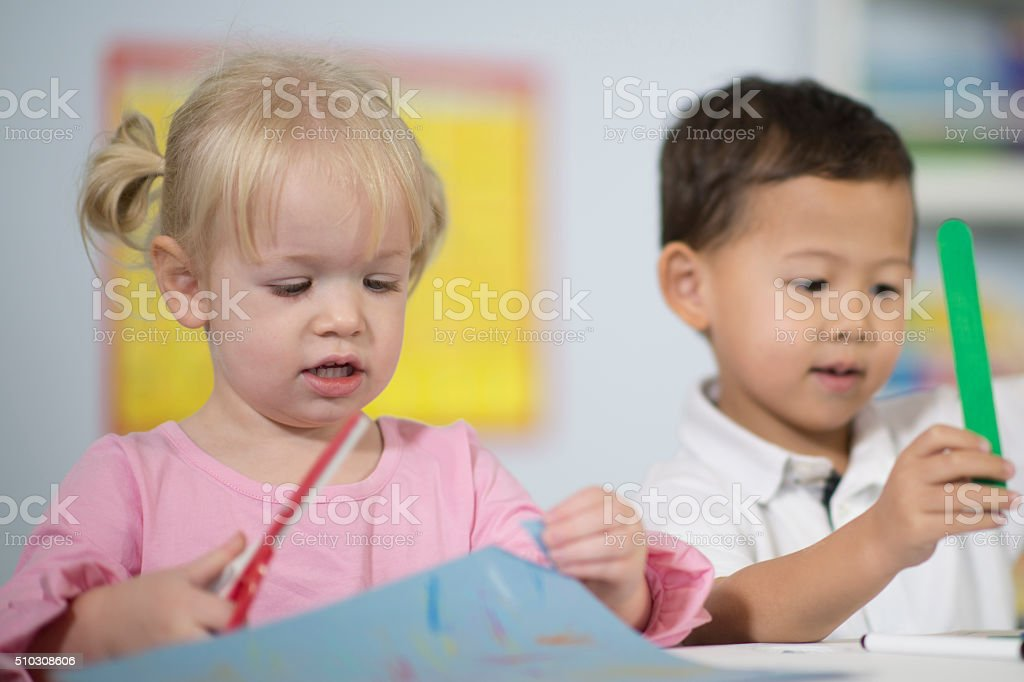 Cutting Paper with Scissors stock photo