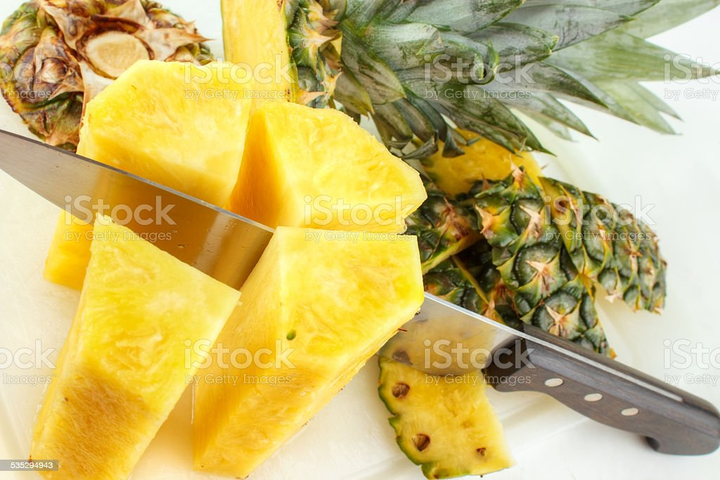Cutting pineapple royalty-free stock photo