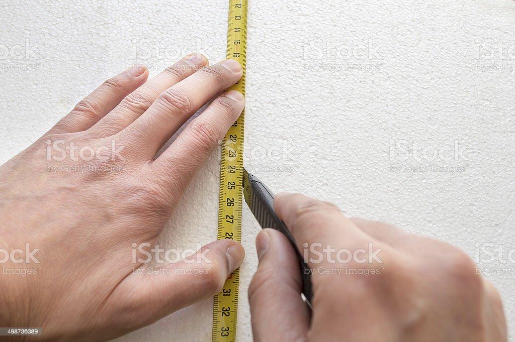 cutting polystyrene stock photo