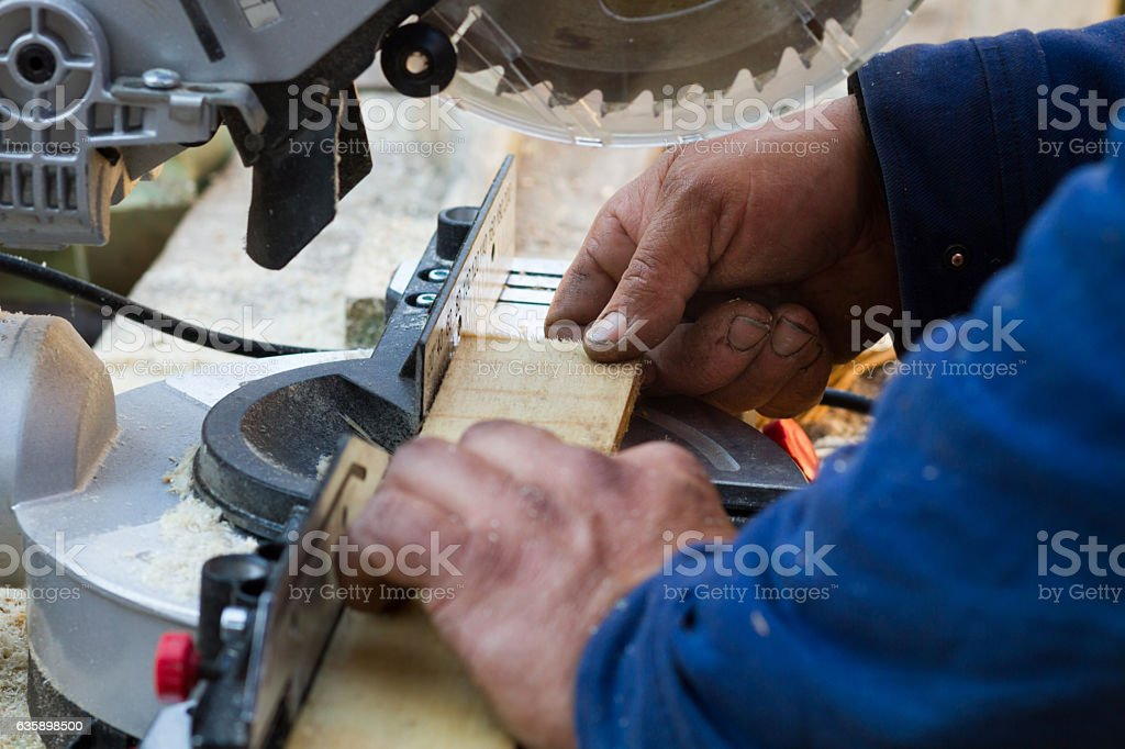 cutting process of wooden material stock photo