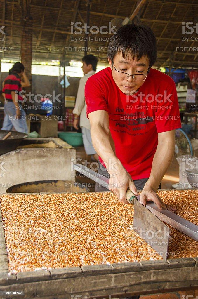 Cutting puffed rice bars royalty-free stock photo