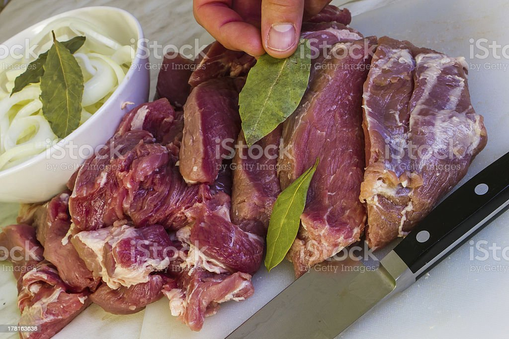 Cutting raw meat royalty-free stock photo