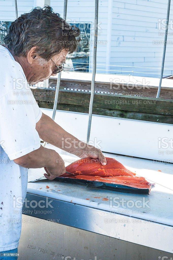 Cutting Salmon Filets stock photo