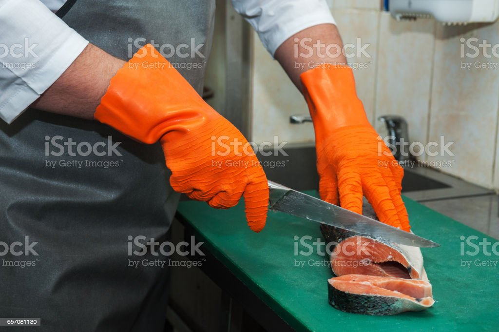 cutting salmon fish stock photo