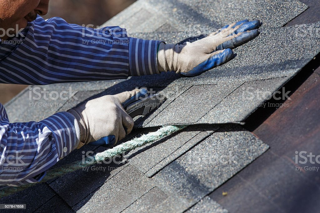 Cutting Shingle to Fit stock photo