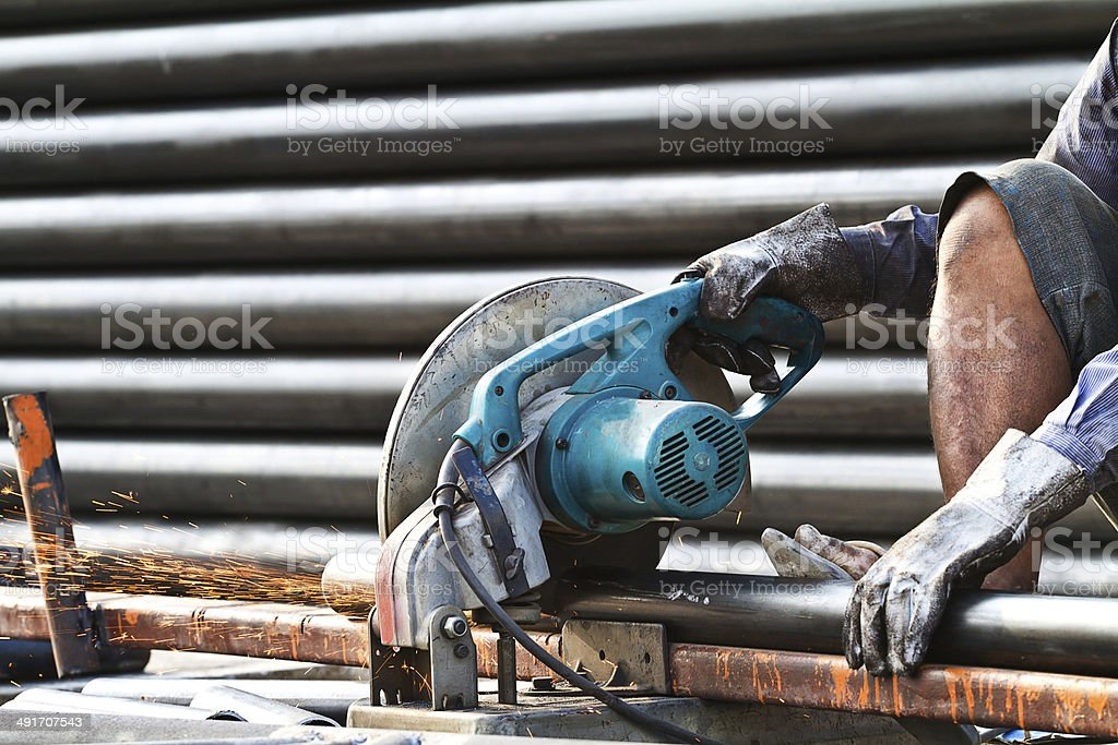 cutting steel with machine for cutting steel by worker stock photo