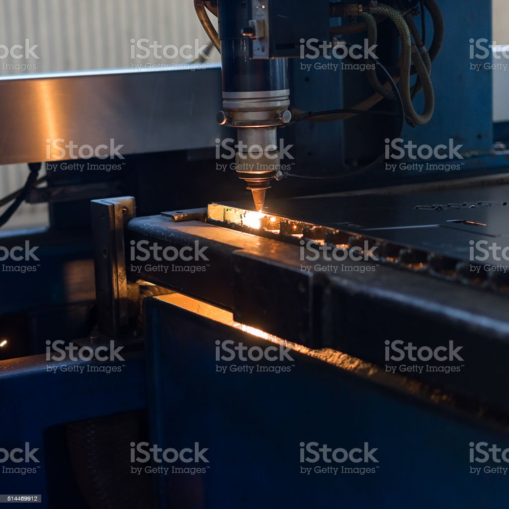 cutting stencilled patterns into metal stock photo