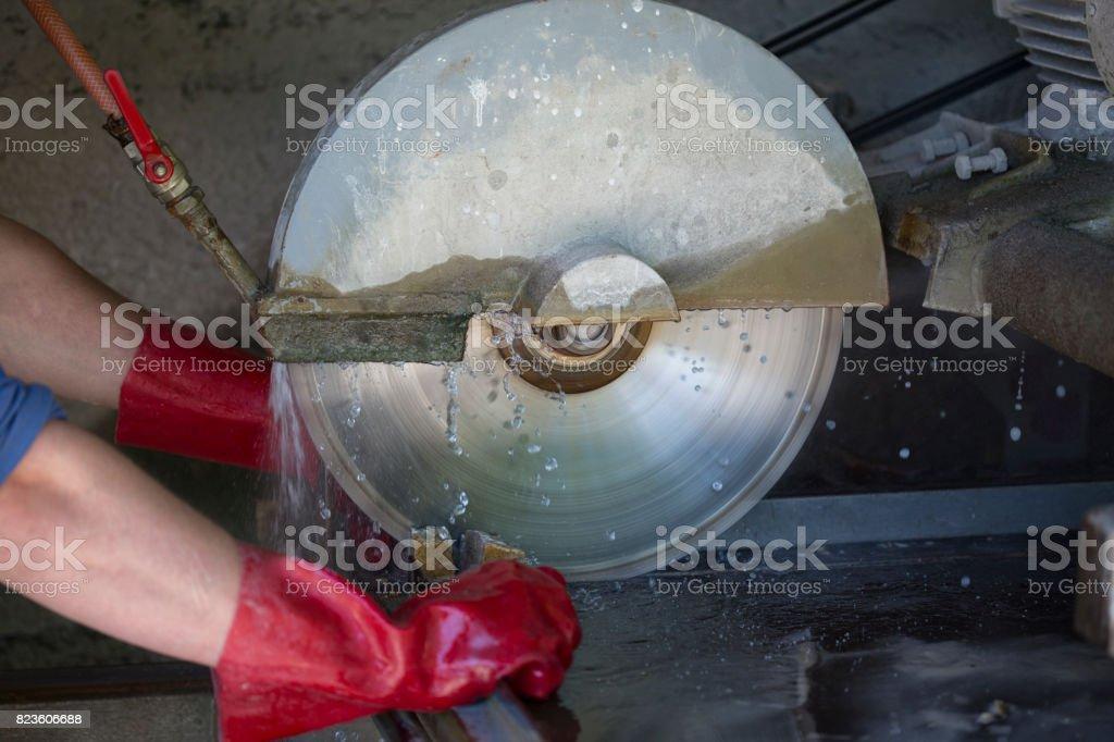 Cutting stone stock photo