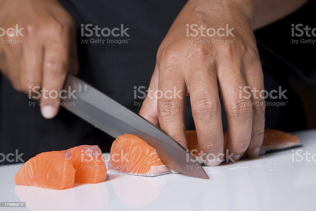 Cutting Sushi stock photo