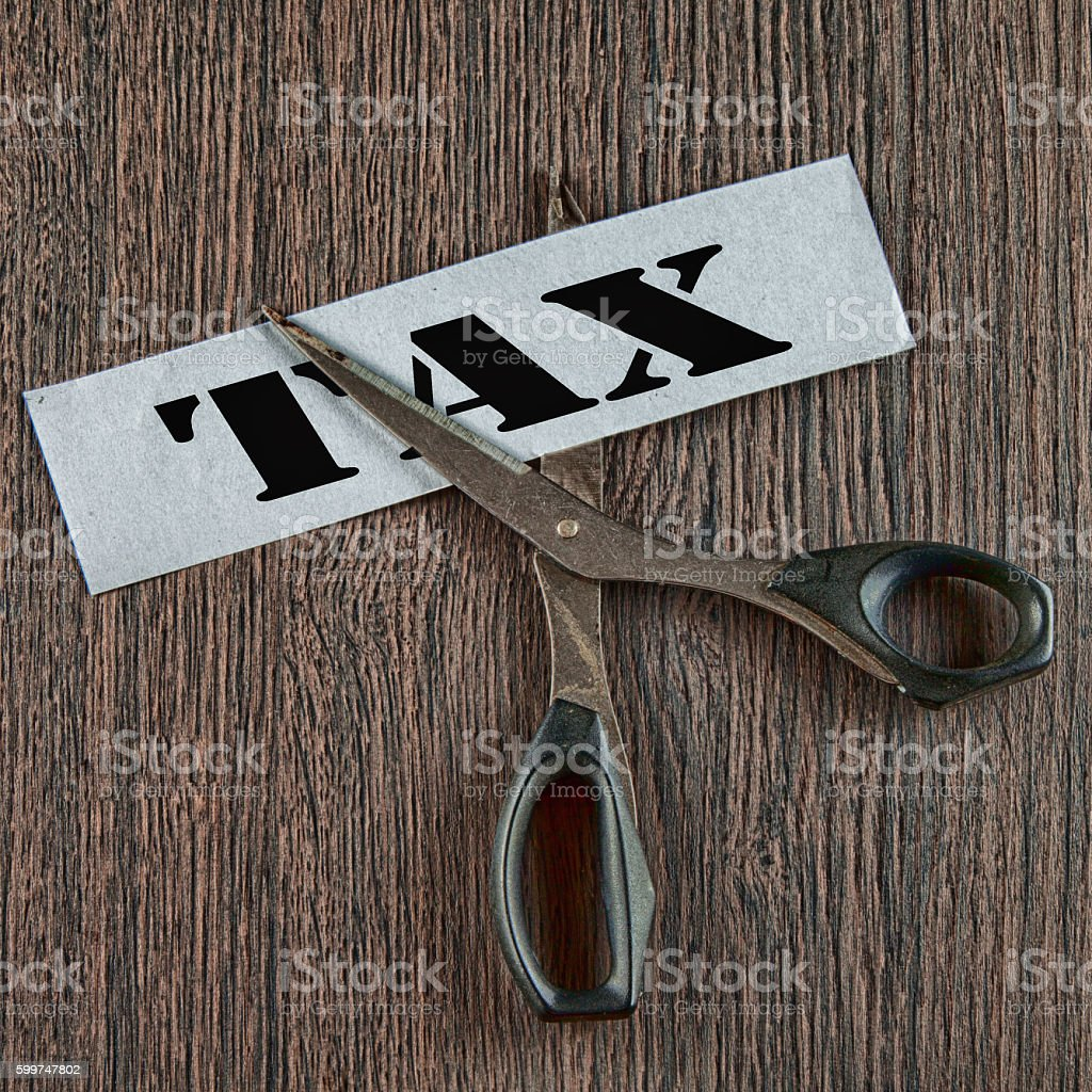 Cutting tax image stock photo