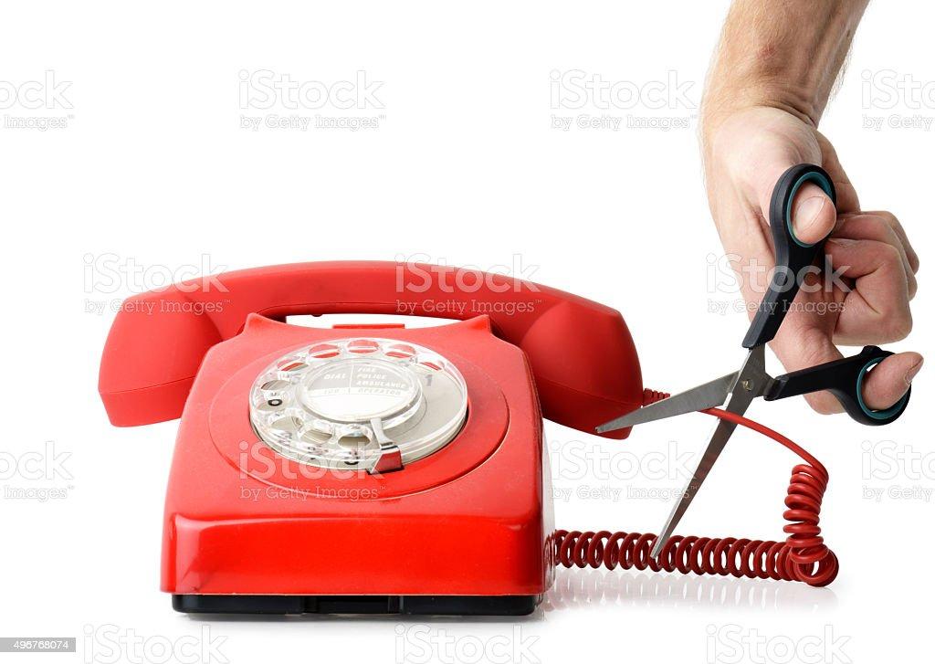 Cutting telephone cord stock photo
