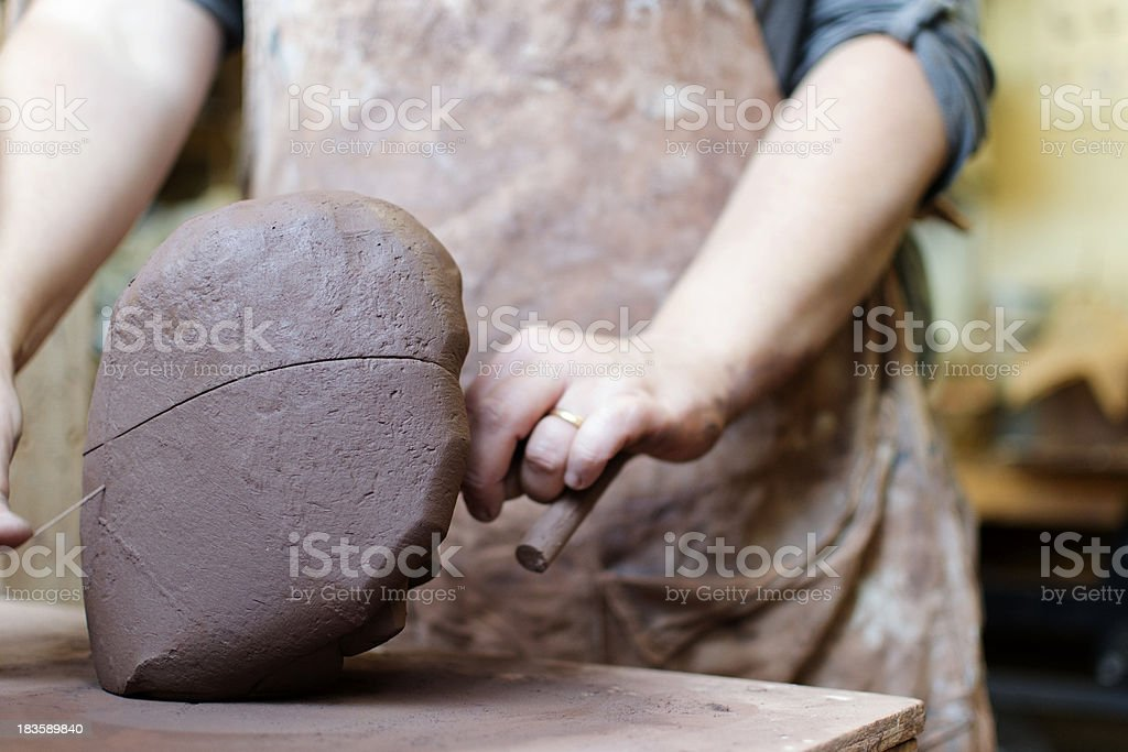 Cutting the clay royalty-free stock photo